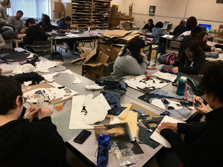 Students in fourth period Visual Arts 2 actively work on denim portraits.