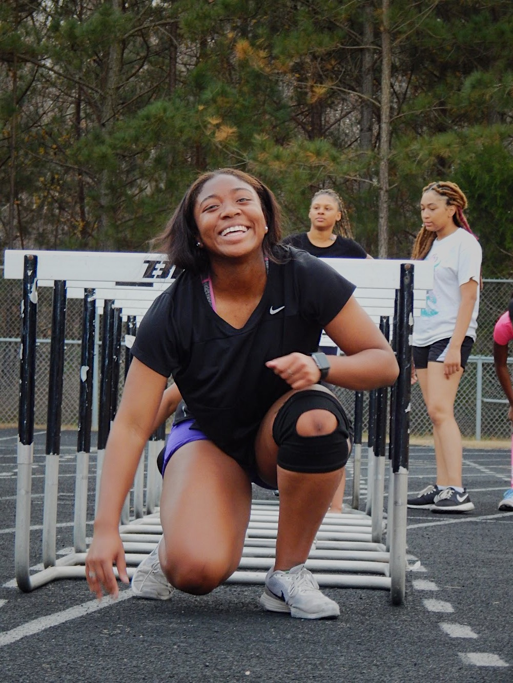 Jasmine Wilson- Johnson does a hurdle exercise during practice.