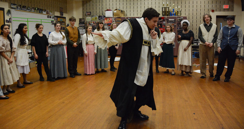 Senior, Nate Richardson, who plays Beast, leads warmups before Beauty and The Beast Performance.
