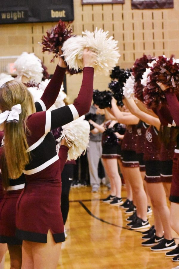 Wakefield's cheerleaders welcome the basketball onto the court.