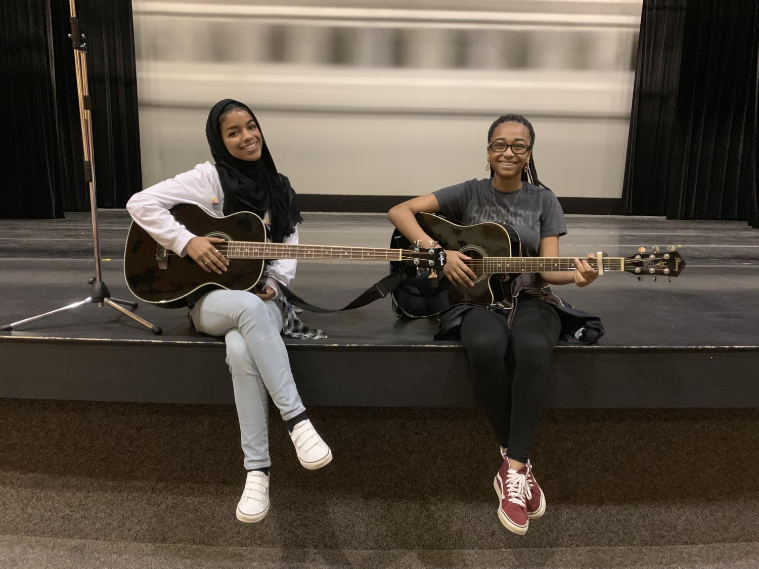 Seniors, Brianna Williams (right) and Hubs Muhammad (left) practice before the senior talent show.