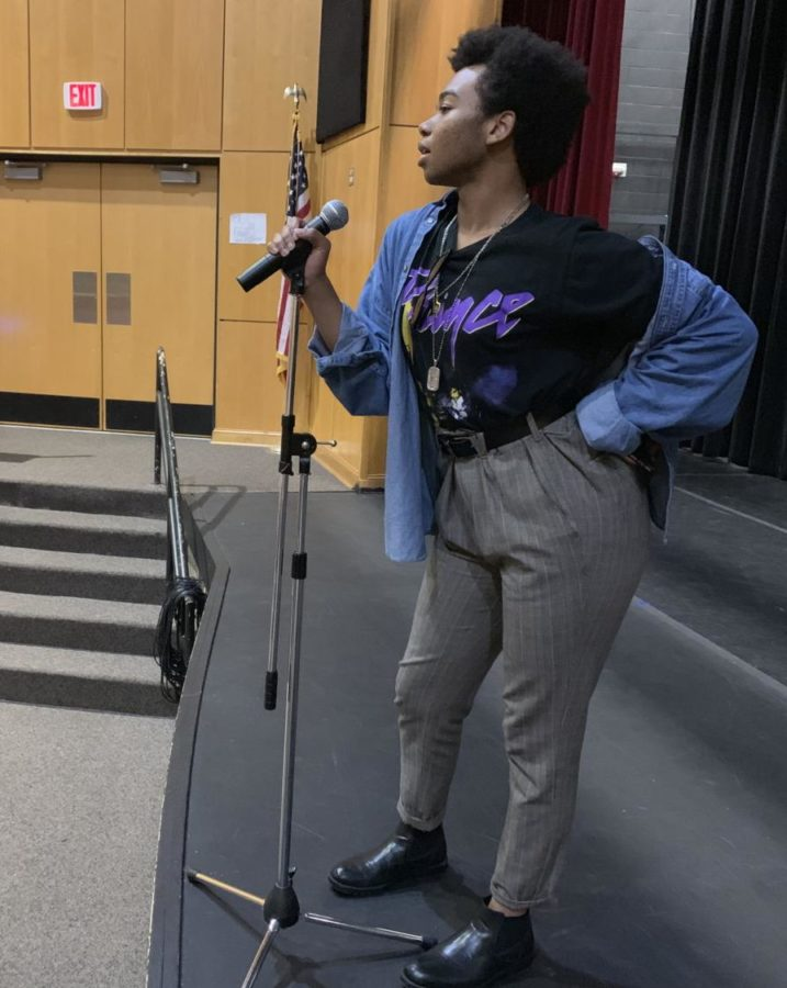 Senior, Kyle Harris rocks the stage while rehearsing his talent show performance.