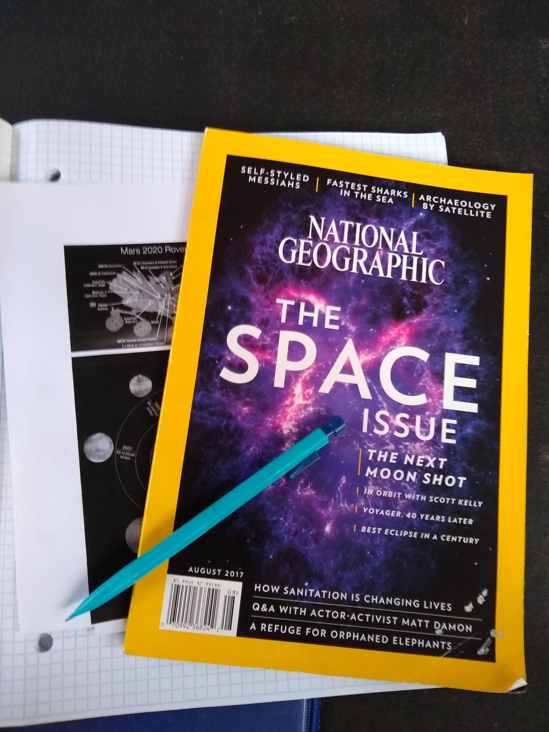 Stacked reading materials share information all about recent space exploration.