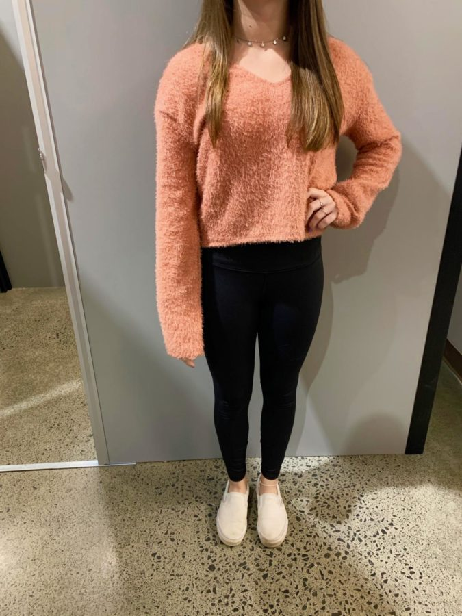 Fuzzy orange sweater $2, black leggings $1.99.