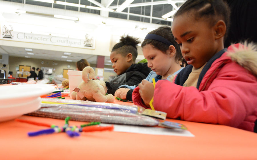 Kids create crafts in the commons area.