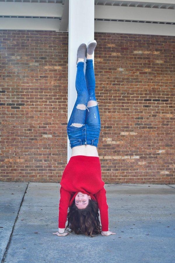 Halen does a handstand.
