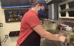 Lauren Wallace, Zaxby's employee, changes out the dishes.