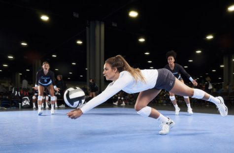 Volleyball players during a match.