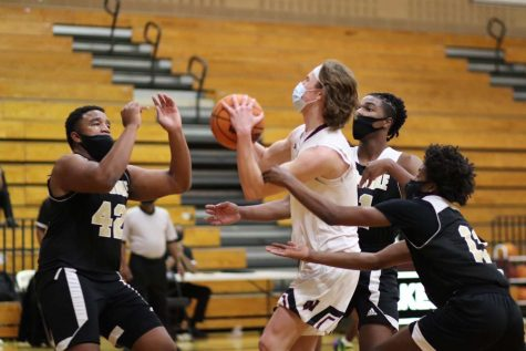 Sophomore Hayden Doebler fights through the Knightdale defense.