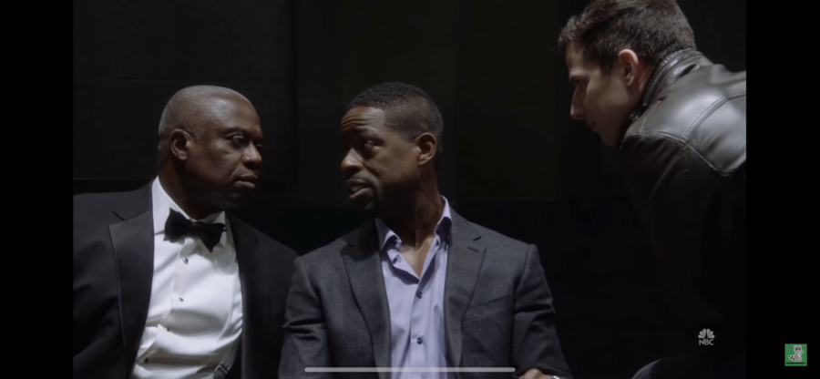 Holt and Peralta interrogate Philip about the murder of his co-worker Robert.