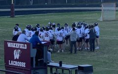 The Wakefield lacrosse team huddles up for a team meeting.