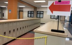 A large red arrow directs students and staff past the chained-off locker bays.