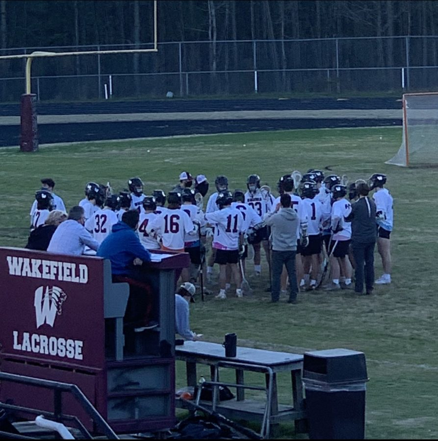 The Wakefield men's lacrosse team huddles up to discuss their next move.