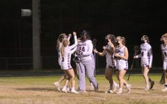 Wakefield womens lacrosse team congratulates their goalie, Ava McLary after a hard-fought game.