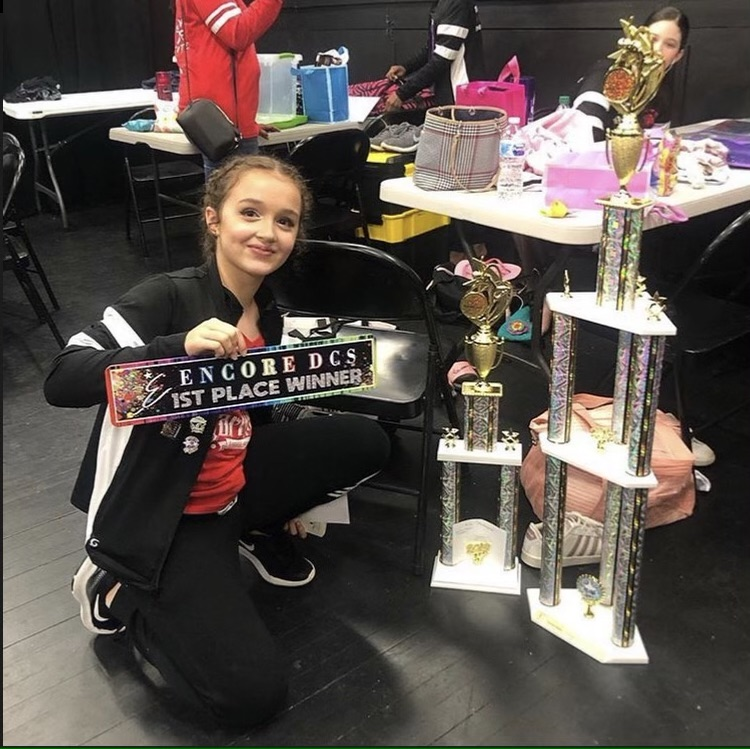Sofia Colvin, a freshman at Wakefield High, displays her trophies from dance competitions.