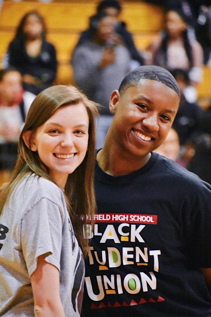 Kaitlyn Peterson and Senior Vice President Anthony Howard pose for a picture together before doing the pep rally M.C.