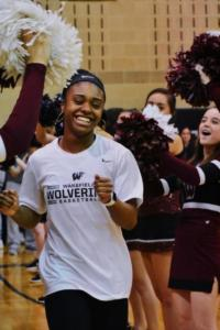 Gabrielle Donaldson shines with joy as she jogs onto the court.